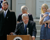 "FILE - In this Aug. 17, 2007, file photo, Rep. J. Dennis Hastert, front, R-Ill., announces that he will not seek reelection for a 12th term as he stands on the steps of the old Kendall County courthouse with, from left, his son Josh; wife Jean; and daughter-in-law Heidi, grandson Jack, in Yorkville, Ill. A newly unveiled indictment against Hastert released Thursday, May 28, 2015, accuses the Republican of agreeing to pay $3.5 million in hush money to keep a person from the town where he was a longtime schoolteacher silent about ""prior misconduct."""