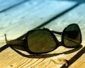 sunglasses on a wood table